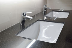 Modern style faucet with granite counter top Stock Photos