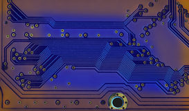 Modern style hardware technology concept with blue circuit board. Macro view electronic chip soldering paths and trace Royalty Free Stock Photos