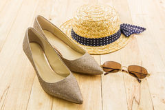 Modern style image of female fashion: straw hat, sun glasses and Stock Image
