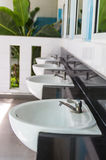 Modern style interior design of a washbasin at public toilets Stock Photos