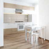 Modern style kitchen in white. Stock Images