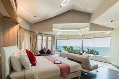 Modern style of living room with bed and sea view Stock Images