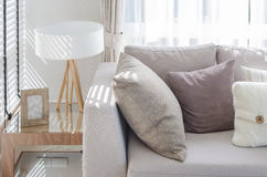 Modern style living room with pillows on sofa and modern lamp on Royalty Free Stock Photos