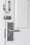 Modern style metal locked with chain and door knob. Stock Photography