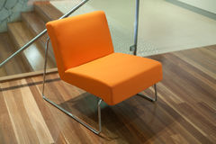 Modern style orange chair Royalty Free Stock Photos