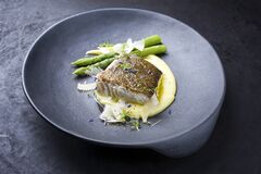 Free Modern Style Traditional Fried Skrei Cod Fish Filet With Green Asparagus Tips And Mashed Potato Creme In Parmesan Olive Oil Sauce Royalty Free Stock Image - 215730686