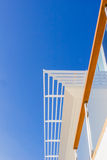 Modern style villa: louvers, handrail and blue sky Stock Image