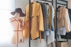 modern style wardrobe with clothes hanging stock photo