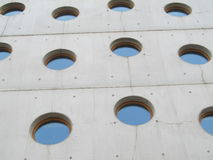 Modern style. White and modern building with round windows royalty free stock photo