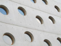 Modern style. White and modern building with round windows stock photography