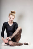 Modern style woman ballet dancer full length on gray Royalty Free Stock Photo