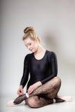 Modern style woman ballet dancer full length on gray Stock Photos