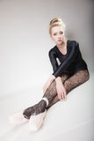 Modern style woman ballet dancer full length on gray Royalty Free Stock Photo