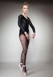 Modern style woman ballet dancer full length on gray Royalty Free Stock Photography