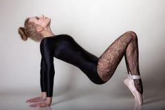 Modern style woman ballet dancer full length on gray Royalty Free Stock Photos