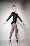 Modern style woman ballet dancer full length on gray Royalty Free Stock Image
