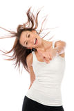 Modern style woman dancer dancing. Modern style girl dancer dancing and cheerful smiling with windy blowing hair isolated on a white background royalty free stock photo