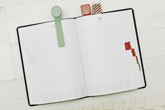 Modern-styled diary with cozy bookmarks Royalty Free Stock Photography