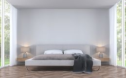 Modern styles bedroom with garden view 3d rendering image. There are white wall and wooden floor finished with fabric bed.There are large window overlooking the Royalty Free Stock Image