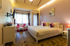 Modern styles of bedroom. At resort in Thailand royalty free stock photography