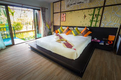 Modern styles of living room with pool. At resort in Thailand stock photography