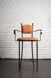 Modern stylish  chair against a  brick wall Royalty Free Stock Images