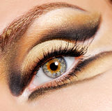 Modern and stylish coloured eye make-up. Human eye of woman with modern and stylish coloured eye make-up stock photos