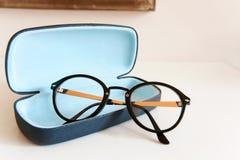 Modern stylish fashionable elegant black eyeglasses in blue leat Royalty Free Stock Photography