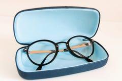 Modern stylish fashionable elegant black eyeglasses in blue leat Stock Photography