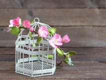 Modern and stylish floral wreath on birdcage. Royalty Free Stock Photo