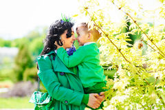 Modern stylish happy mother holding little son Stock Photo