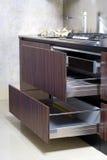 Modern stylish kitchen. Opened drawers in modern stylish kitchen Royalty Free Stock Images