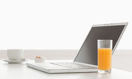 Modern and stylish laptop on a table Royalty Free Stock Images