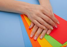 Modern stylish manicure rainbow or summer mood, on a blue table with colored envelopes top view stock image
