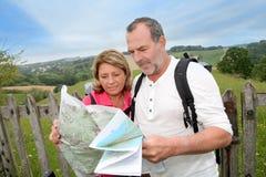Modern stylish senior couple hiking and sightseeing royalty free stock photos