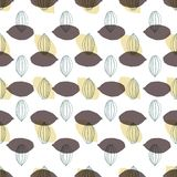 Modern stylized cocoa pods shapes in a geometric arrangement seamless vector pattern background. royalty free illustration