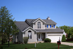 Modern suburban home. Exterior of detached modern suburban home with blue sky background Stock Photo