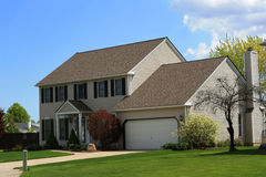 Modern suburban home. Exterior of detached modern suburban home with lawn in foreground Royalty Free Stock Image