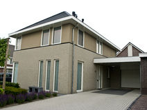 Modern suburban house. Elegant modern suburban house with a parked car. Dutch architecture royalty free stock images