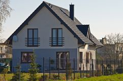 Modern suburban house in spring, Poland royalty free stock image