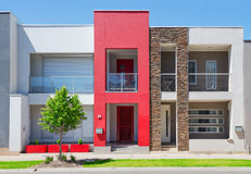 Modern Suburban House. Typical facade of a modern town suburban house at noon stock images