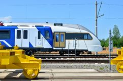 Modern subway rolling stock and European high-speed passenger train on an open railway area of the rail car assembly plant. Modern subway rolling stock and royalty free stock image