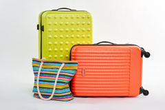 Modern suitcases and textile handbag. Stock Image