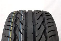 Modern summer car tire. Brand new modern summer car tire for rain Royalty Free Stock Image