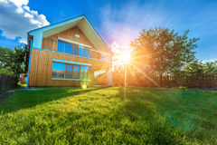 Modern summer cottage against a blue sky in the summer garden Royalty Free Stock Images