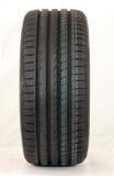 Modern summer sports car tire. Brand new modern summer sports car tire Royalty Free Stock Photo