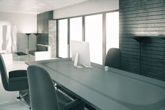 Modern sunny loft office with furniture and computer Stock Photos