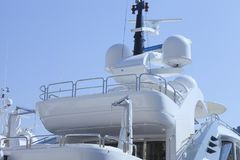 Modern super yacht top deck against blue sky . Royalty Free Stock Photo