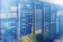 Modern supercomputers in computational data center. Multiple exposure. Server room in data center full of telecommunication equipment. internet. big data Royalty Free Stock Images