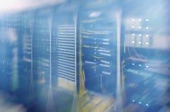Modern supercomputers in computational data center. Multiple exposure. Server room in data center full of telecommunication equipment. internet. big data Stock Photos